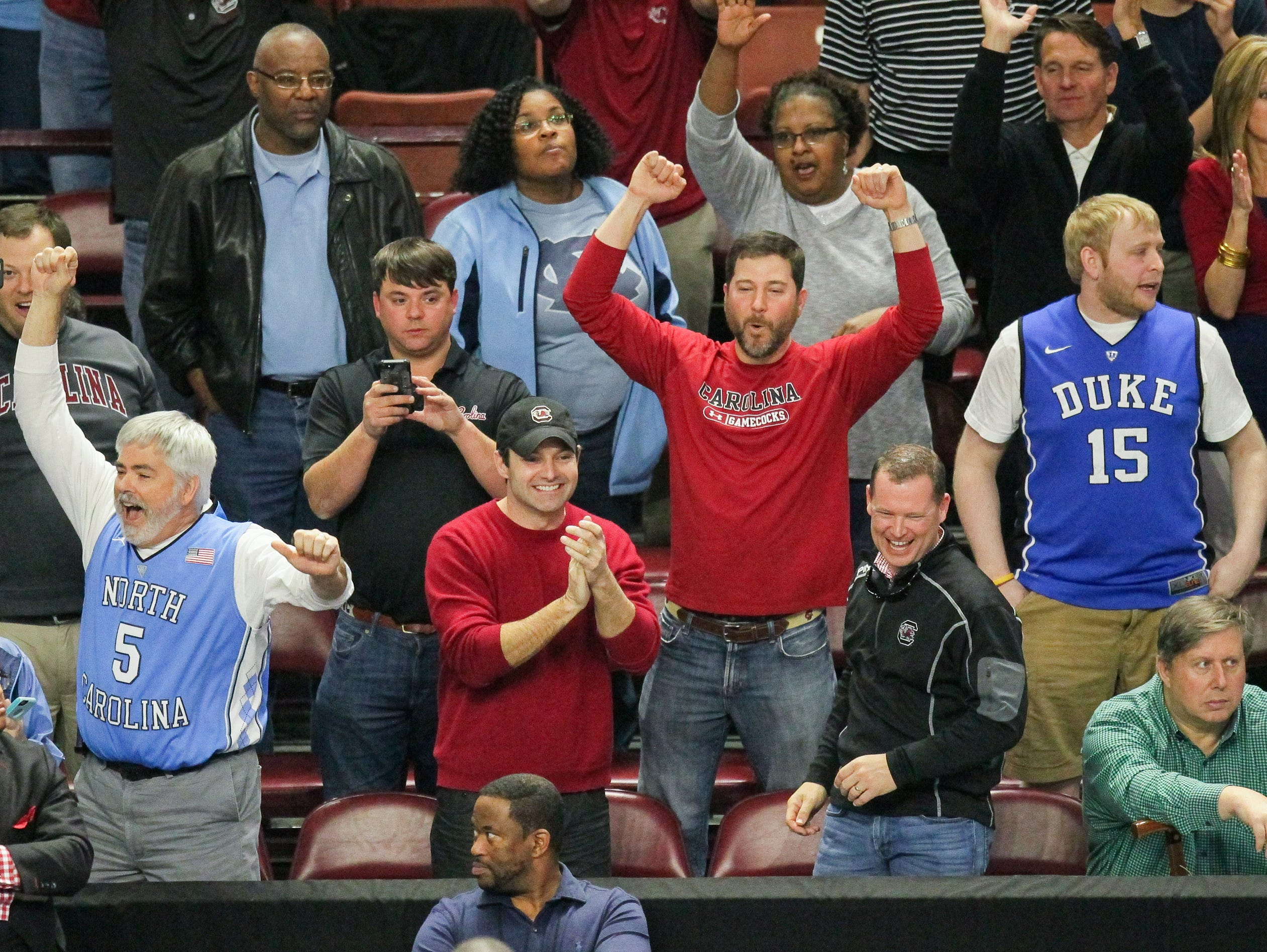 South Carolina fans celebrate near cheering North Carolina fans after beating Duke 88-81 during the 2nd round of the NCAA Tournament at Bon Secours Wellness Arena in downtown Greenville on Sunday, March 19, 2017.