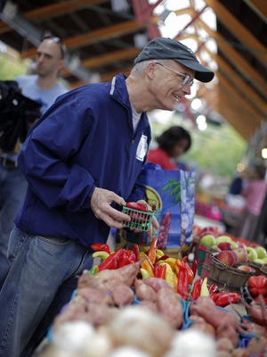 Teacher and Over-the-Rhine resident Jack Hennen has been stopping by Findlay Market for more than 25 years. In this 2012 photo he was checking out hot peppers from Neltner's Farm.