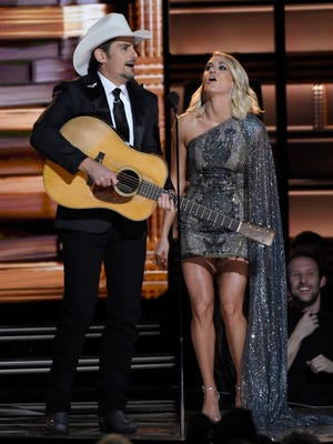 Co-hosts Brad Paisley and Carrie Underwood perform their opening monologue at the 2016 CMA Awards on Nov. 2, 2016, in Nashville.