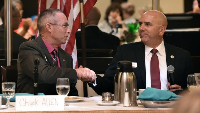 Washoe County Sheriff candidate Chuck Allen, left, and Tim Kuzanek shake hands after a forum at the Atlantis Resort on August 14, 2014.