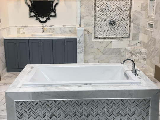 The latest fashion trends for the bath are shown in new vignettes like this one at The Tile Shop, West Allis.