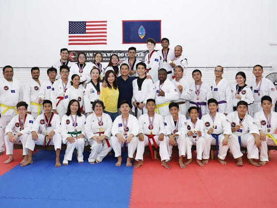 Medalists shown with Master Noly Caluag, center, during the recent 2018 Master Noly's Taekwondo Sparring Tournament.