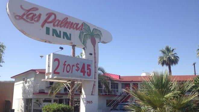 Phoenix police served warrants at the Las Palmas Inn on Grand Avenue on May 21, 2014.