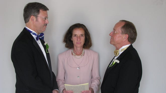 Bishop Gene Robinson, right, and Mark Andrew are shown during their private civil union ceremony performed by Ronna Wise in Concord, N.H., in 2008.