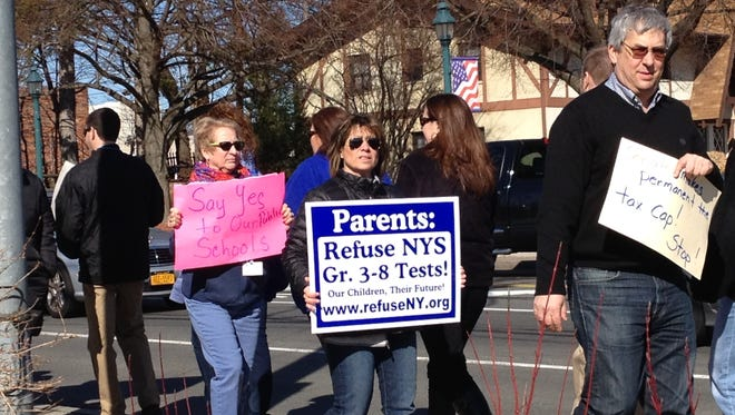 Teacher unions and concerned parents protested the state Senate's budget proposal for 2014-15 school year on Friday, March 21, 2014, outside the Nanuet offices of State Sen. David Carlucci, D-New City.