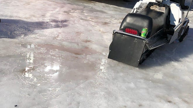 Puddles of water could be found all over the infield section during the Midwest International Racing Association FireRite 250 at the Alcona County Recreation Area in Lincoln, MI on Saturday, Feb. 22, 2020. With the warm weather during most of the winter the track was much slower as the snowmobiles had to race through the slush when they prefer and go much faster on packed snow and ice.