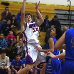 Boys basketball: Reno holds off Reed