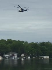 The New Jersey State Police Aviation Unit searches Lake Hopatcong for a missing person.