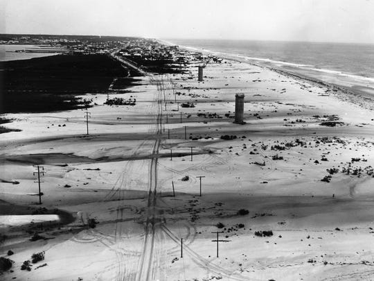 This photo is looking north along Del. 1 toward Dewey Beach. The dunes were flattened when the ocean and bay met during the March Storm of 1962.