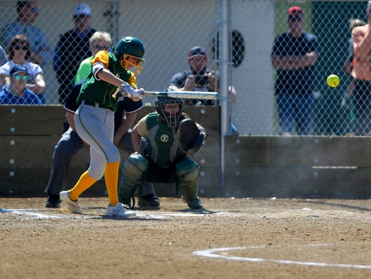 CMR's Madi Moore lines a hit to left field during Thursday's