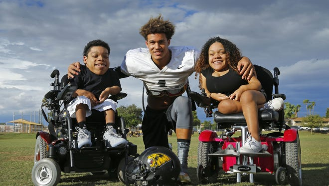 Saguaro High football player Byron Murphy (17) with his biggest fans, his 2 cousins, Justin and Kianna White, on Wednesday, Oct. 21, 2015 in Scottsdale.