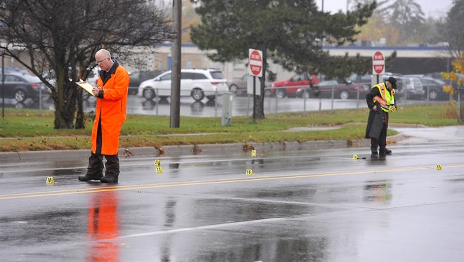 Police and investigators work at the scene of Wednesday's crash involving a Waverly High School student.