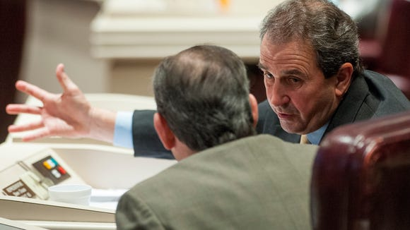 Rep. Steve Clouse chats on the house floor at the Alabama