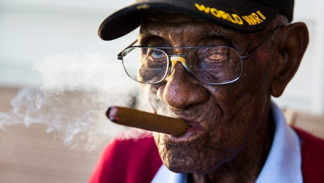 Richard Overton, 111, smokes a cigar on his front porch on Thursday, May 25, 2017 on Hamilton Avenue in Austin, Texas. Overton is known for smoking cigars and drinking whiskey on his front porch. He is the oldest living U.S. war veteran. (Ashley Landis/Dallas Morning News/TNS)