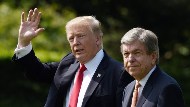 U.S. President Donald Trump and U.S. Senator Roy Blunt (Mo.) depart the White House on Aug. 30, 2017 in Washington, D.C. President Trump is traveling to Missouri to push his tax reform. (Olivier Douliery/Abaca Press/TNS)