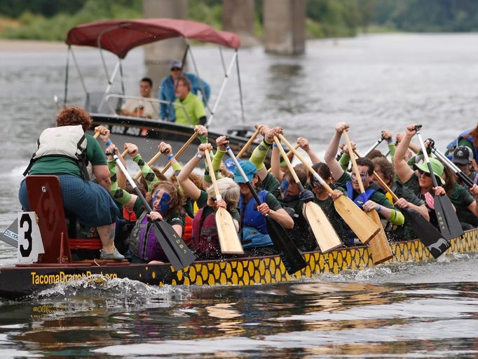 The Highland Dragons competes in one of the heats in the Dragon Boat races during the World Beat, at Riverfront Park, on Sunday, June 29, 2014.