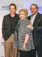Mizell Executive Director Ginny Foat with (l-r) Johnny