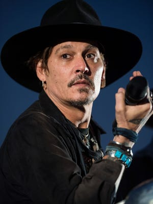 Johnny Depp introduces a screening of 'The Libertine' film at the Cineramageddon cinema on day one of the Glastonbury Festival.