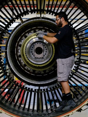 General Electric said it would record a big charge related to its struggling power unit.