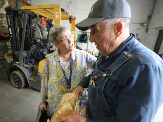 The Rev. Patricia Bruger with Frank Hoogerheid of Midland Park. Hoogerheid is a regular contributor to CUMAC, here dropping off loaves of bread.