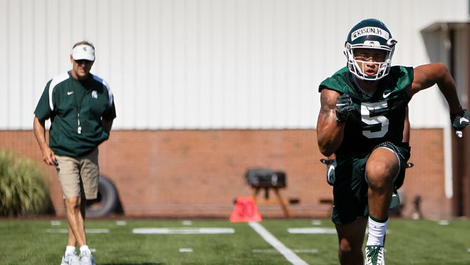 MSU Football Coach Mark Dantonio watches freshman WR Hunter Rison Monday, July 31, 2017, during MSU's first football practice.