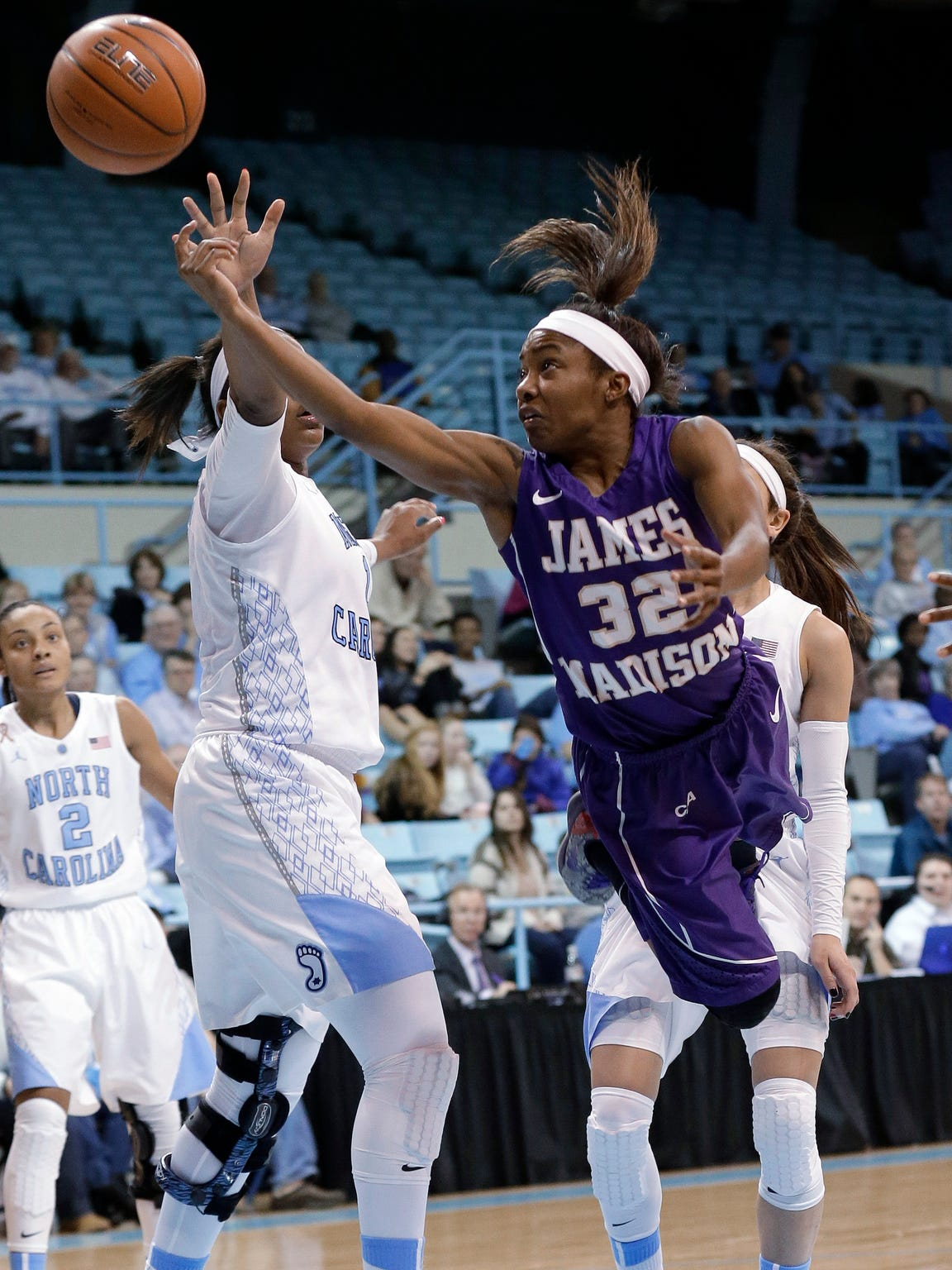 James Madison's Angela Mickens (32) drives to the basket