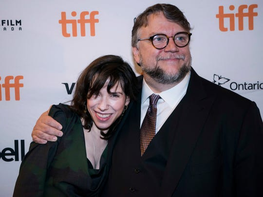 Sally Hawkins, left, and director Guillermo del Toro arrive for the screening of 'The Shape of Water' at Toronto International Film Festival.