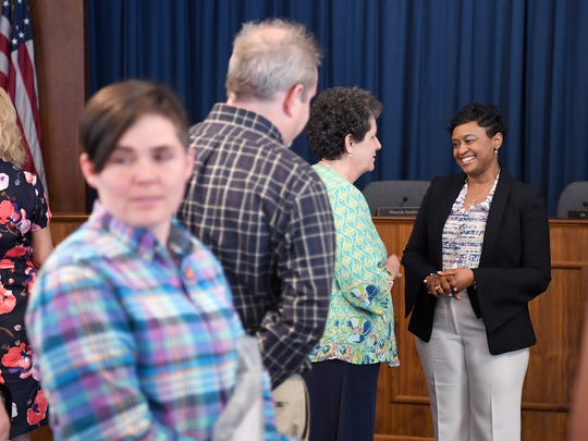 Denise Patterson talks with Laurie McDanel, director of exceptional children, while waiting to meet other staff and community members after being named the new superintendent of Asheville City Schools during a special school board meeting on Thursday, June 1, 2017.