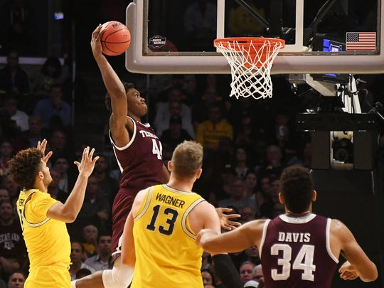 Texas A&M Aggies forward Robert Williams (44) shoots against the Michigan Wolverines in the first half in the semifinals of the West regional of the 2018 NCAA Tournament at STAPLES Center.