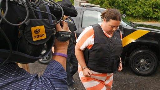St. Lawrence County Sheriffs deputies escort Nicole Vaisey, 25, into Fowler Town Court for her preliminary hearing Thursday in Fowler, N.Y. Vaisey and Stephen Howells II are charged with abducting and sexually abusing two young Amish sisters as the girls worked their familys roadside vegetable stand in Oswegatchie, N.Y., on Aug. 13.