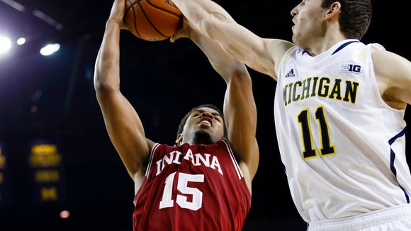 Indiana Hoosiers forward Devin Davis (15) shoots on Michigan Wolverines guard Nik Stauskas (11) in the second half at Crisler Arena. Michigan won 84-80.
