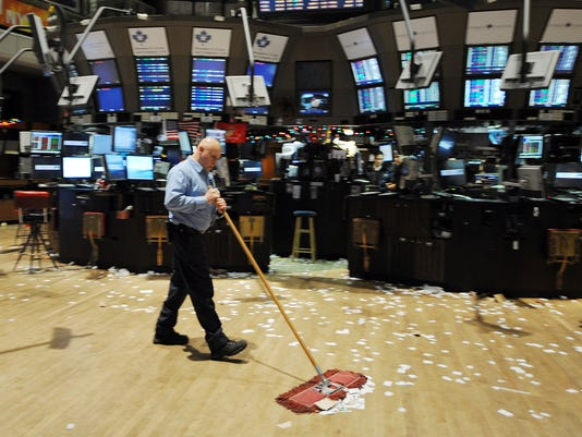 A janitor sweeps the trading floor of th