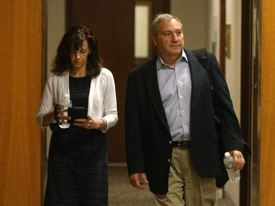 Laura Rideout and Paul Tucci arrive for a read back in the murder trial of Craig Rideout, Laura's ex-husband.  Both are implicated in the murder.