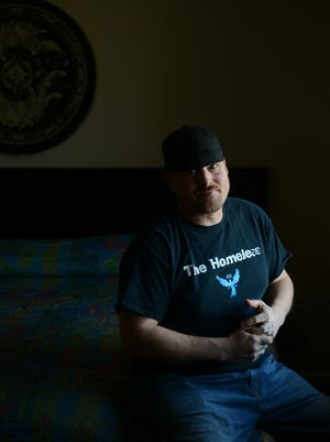 Mike Karl, the founder of the Homeless Angels, in a room at the Burkewood Inn on Monday, Feb. 20, 2017 in Lansing, as announced his resignation from the organization he started.