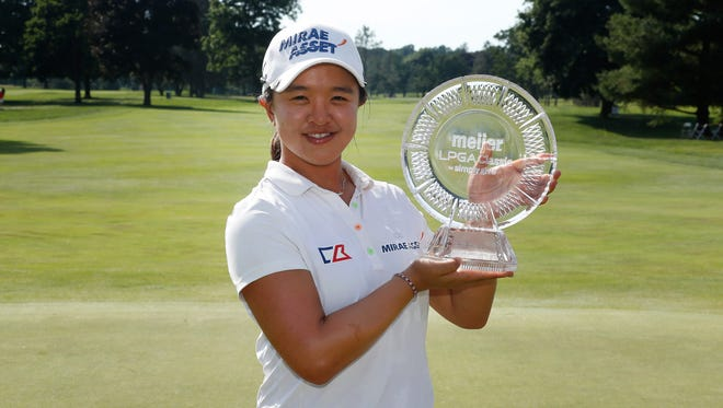 Sei Young Kim of South Korea holds up the championship trophy after winning the Meijer LPGA Classic on the first playoff hole on June 19, 2016 at Blythefield Country Club in Belmont, Michigan.