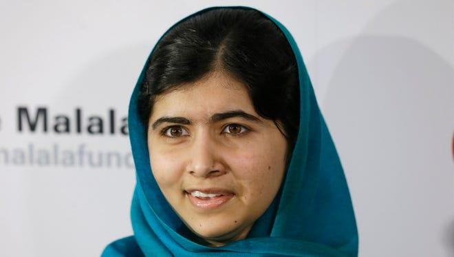 Malala Yousafzai poses for photographs on Thursday in New York.