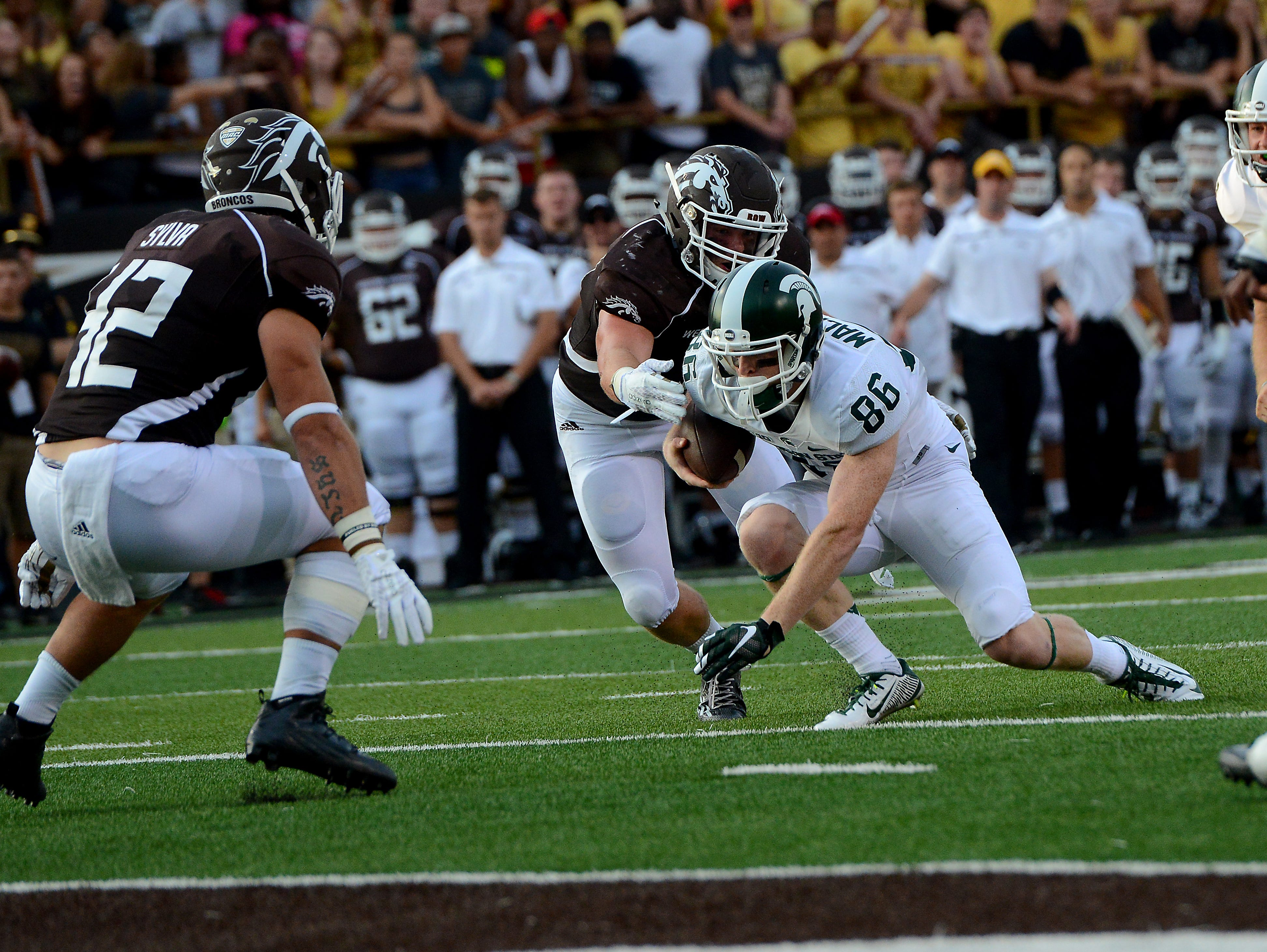 Matt Macksood looks for room to run on a fake extra point attempt against Western Michigan in last year's season opener. Macksood, a Lansing Catholic alum, is MSU's holder and also plays on MSU's punt block team. He's hoping to see time at receiver this fall.