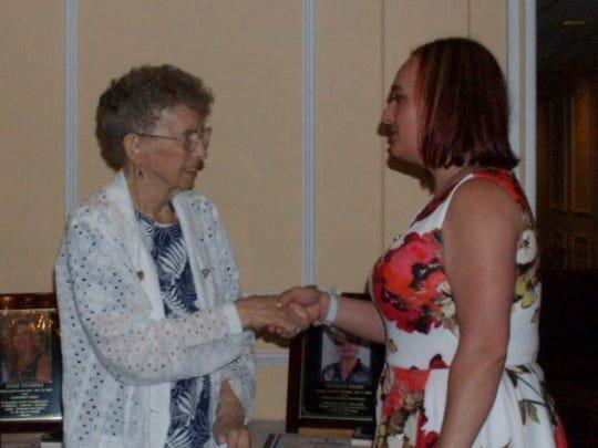 Elaine Wilson, 2012 Hall inductee, inducts Liesl Apgar.