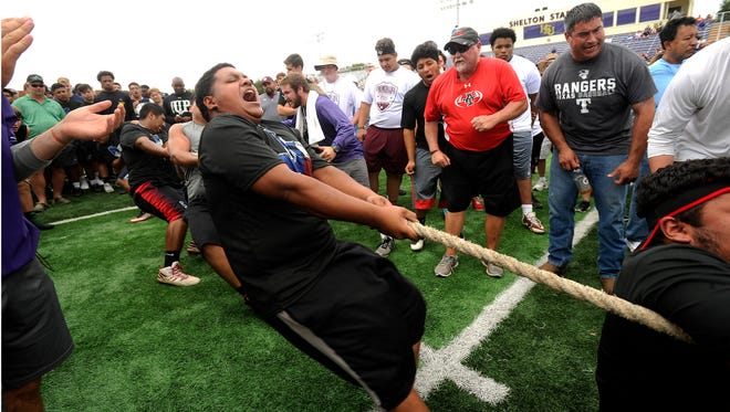 Anson's Israel Delacruz lets out a yell while competing in the tug-of-war during the fourth annual State LineMAN Challenge on Saturday, June 24, 2017, at Hardin-Simmons' University's Shelton Stadium. Anson won the Division 3 championship.