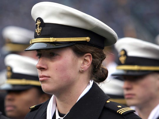 Elizabeth Hoerner stands in formation before the start of the Army-Navy football game at Lincoln Financial Field in Philadelphia. The U.S. Navy said Tuesday, July 10, 2018, it will let women sailors sport ponytails and other longer hairstyles, reversing a policy that long forbade females from letting their hair down.