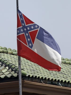 The state flag of Mississippi is unfurled at the Secretary of State's Office building in downtown Jackson. Republican Lt. Gov. Tate Reeves said Mississippi voters, not lawmakers, should decide whether to remove the Confederate battle emblem from the state flag. Reeves, who presides over the state Senate, spoke about the issue a day after Republican House Speaker Philip Gunn called the emblem offensive and said the state flag should change.