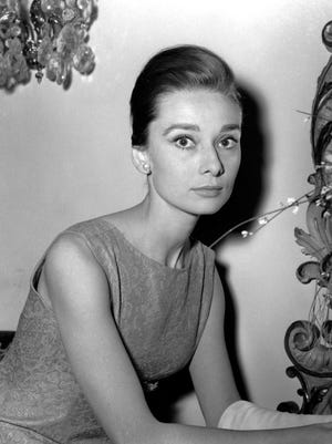 """This Jan. 8, 1960 file photo shows Belgian-born actress Audrey Hepburn at a hotel in Rome. """"Yes, she was an international star, but she was Mrs. Dotti to me,"""" says Luca Dotti, a Rome-based graphic designer who is the son of Hepburn and her second husband, Andrea Dotti. """"And she loved her home life the most. I wanted to bring these two worlds together, the public perception of her, and the woman that I knew."""""""