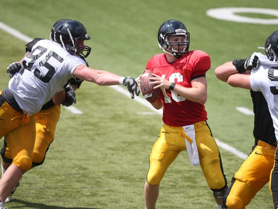 Iowa defensive lineman Drew Ott reaches out for quarterback