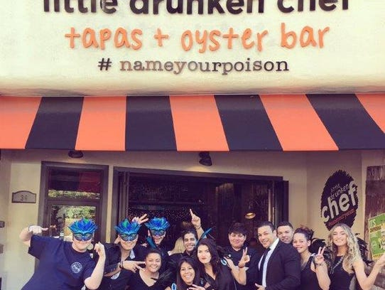 The staff poses outside the Little Drunken Chef