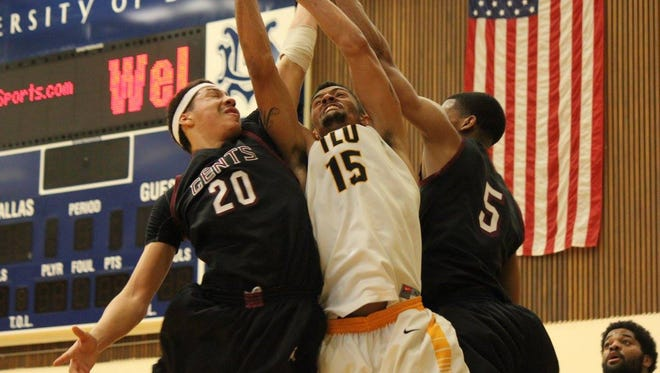 Centenary's Kendall Demouchet (left) and Travion Kirkendoll (right) attempt to block Texas Lutheran forward Donte McGee's shot Sunday in the SCAC tournament championship game at the University of Dallas. Texas Lutheran won 80-75.
