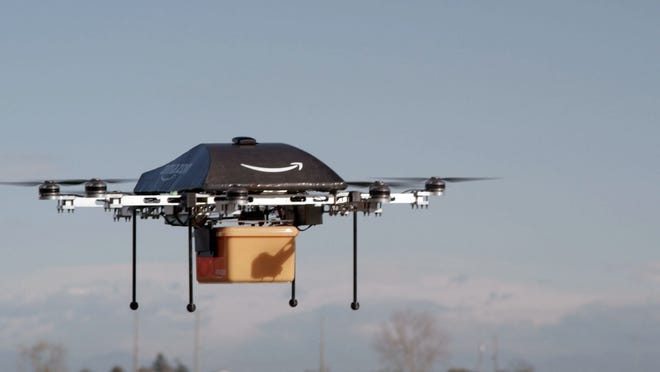 Amazon.com is working on developing unmanned aircraft, such as this one called Prime Air, to deliver packages.