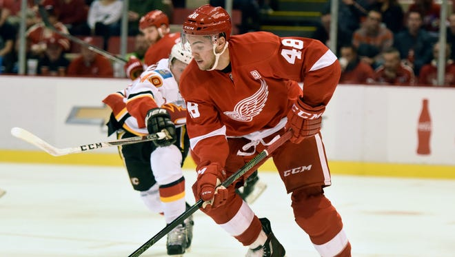 Red Wings defenseman Ryan Sproul skates against the Calgary Flames during the third period in Detroit on Nov. 20, 2016.