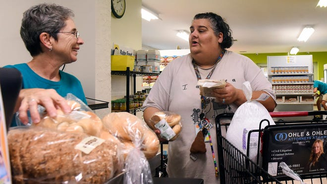 """They've helped us out tremendously. Without them, we wouldn't have made ends meet at the end of some months,"" said Renee Gerold of Stuart (right) after she finished shopping for her Thanksgiving meal Thursday, Nov. 16, 2017, with the help of volunteer, Carol Markus of Sewall's Point, at the House of Hope headquarters on Southeast Bonita Street in Stuart."