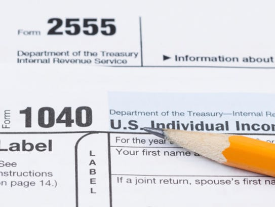 Tax Forms 1040 and 2555