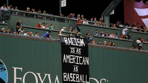 'Racism is as American as baseball' banner unfurled at Fenway Park during Red Sox-A's game
